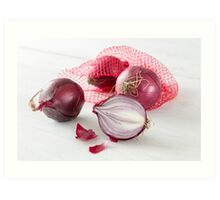 Shallots in the net on white wooden table Art Print