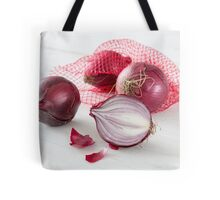 Shallots in the net on white wooden table Tote Bag
