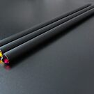 Three black pencils on a black mat by bubblehex08