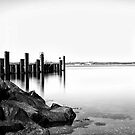 Pier in black and white by Henrik Hansen