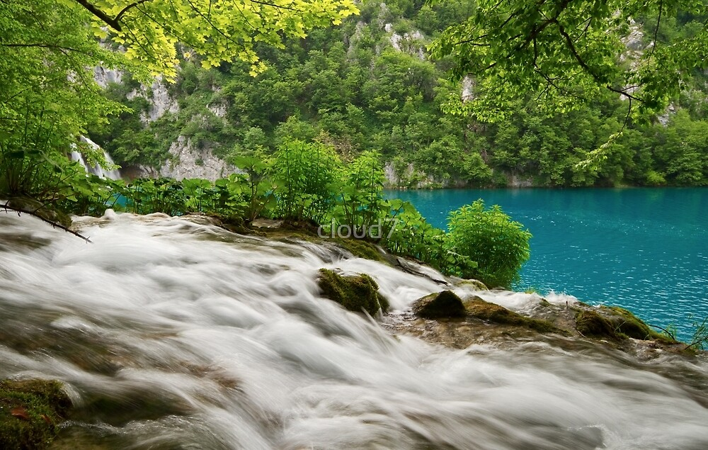 Flowing water and turquoise lake. by cloud7
