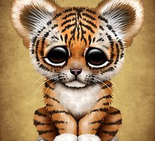 Cute Baby Tiger Cub on Brown by Jeff Bartels