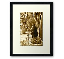 old lady painting Framed Print