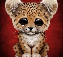 Cute Baby Leopard Cub on Red by Jeff Bartels