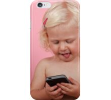 young blonde girl of two, plays with an iPhone on pink background. iPhone Case/Skin
