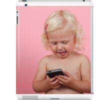 young blonde girl of two, plays with an iPhone on pink background. iPad Case/Skin