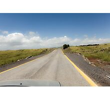 Straight road to vanishing point on the horizon with no traffic.  Photographic Print