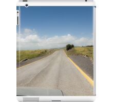 Straight road to vanishing point on the horizon with no traffic.  iPad Case/Skin