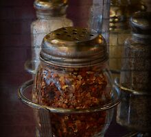 Red Pepper Flakes with Brick by heatherjstewart