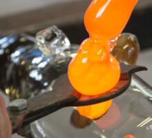 Glassblower cuts molten glass with a hand tool Sticker