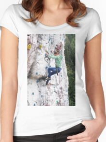 Young teen girl climbs up an artificial climbing wall  Women's Fitted Scoop T-Shirt
