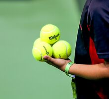 ballboy waiting on the side of a tennis court  by PhotoStock-Isra