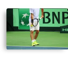 Tennis player in white clothes ready to serve a ball Canvas Print