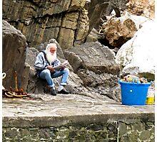 fisherman reading paper Photographic Print