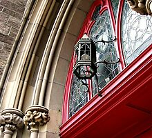 Wrought Iron Lamp Above the Red Doors - St John's Cathedral by Jane Neill-Hancock