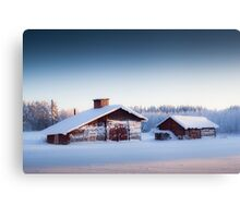 Barn in winter landscape Canvas Print