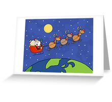 Santa Waving And Flying Over Earth Greeting Card