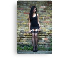 Dark haired beauty in a short black dress  Canvas Print