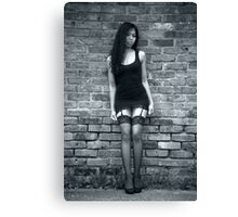 Dark haired beauty in a little black dress Canvas Print
