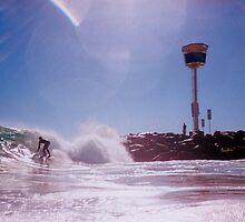 Surfer At City Beach Groyne by robertemerald