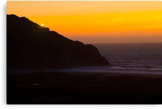 Sunset and lighthouse by lightportal