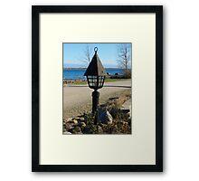 Lighting up the shoreline Framed Print