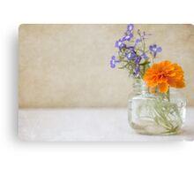 Marigold and Lobelia in a jar vase Canvas Print