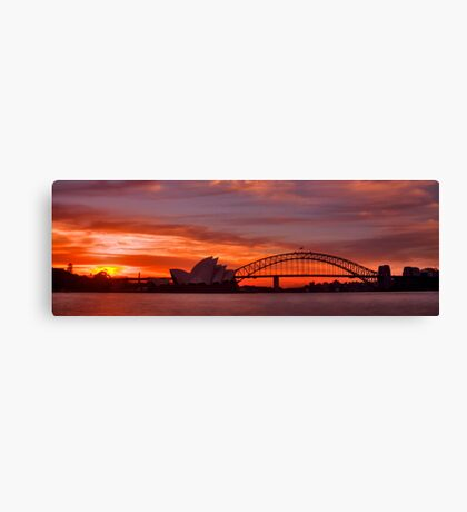 As the sun goes down behind the coat hanger Canvas Print