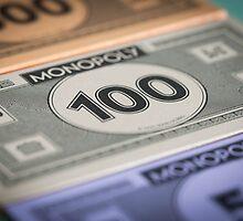 Monopoly money by Darren Sharp