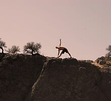stretching in the desert by Amanda Huggins