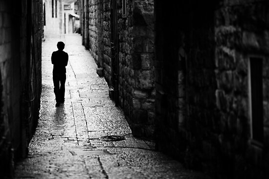 Jerusalem streets walker by waitin' for rain