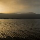 The sun sets over a misty Derwentwater by Dave Hudspeth