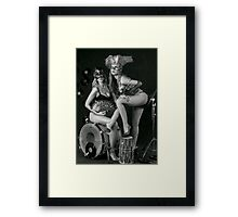 Two sexy ladies wearing masks in music club stage... Framed Print