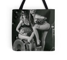 Two sexy ladies wearing masks in music club stage... Tote Bag