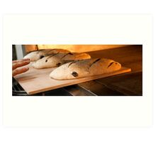 Loaves of bread in a bakery oven. Art Print