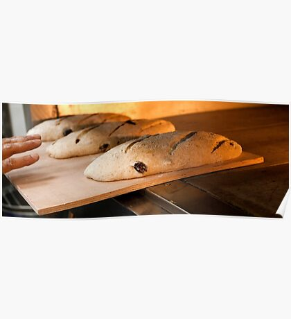 Loaves of bread in a bakery oven. Poster