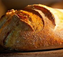 Freshly baked loaf of bread at a bakery.  by PhotoStock-Isra