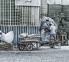 Marble sculptor in Carrera, Italy by cgarphotos
