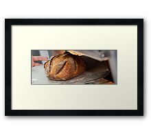 Freshly baked loaf of bread at a bakery. Framed Print