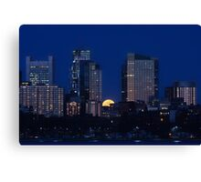 Pink moon, blue city Canvas Print