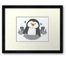 Penguin on a banner Framed Print