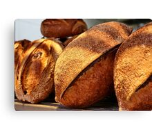 Freshly baked loaves of bread at a bakery Canvas Print