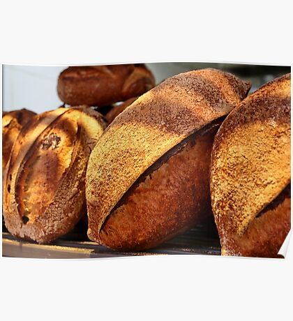 Freshly baked loaves of bread at a bakery Poster