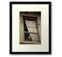 Face in the Window Framed Print