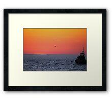 Chasing the sun. Framed Print