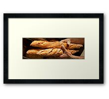 Freshly baked loaves of bread at a bakery. Framed Print