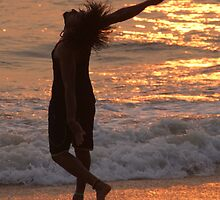 Dancing in the Surf at Sunset by SerenaB