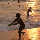 Frisbee Thrower on Varkala Beach at Sunset by SerenaB