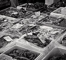 She sells sea food in the Tsukiji market stall - Japan by Norman Repacholi