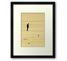 Balancing on wires Framed Print